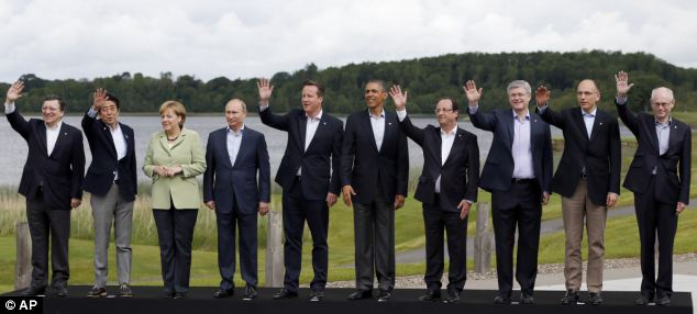The leaders posed for a photo in front of the lake