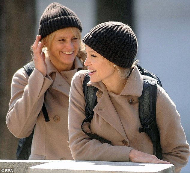Working together: Ms Huthart and Ms Jolie together on the set of 2010 spy thriller Salt