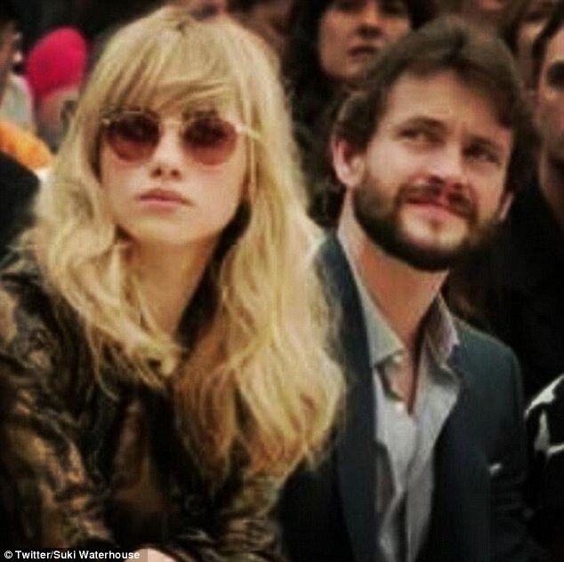 Catwalk queen: Suki posted a snap on her Twitter page of her taking in the action on the front row at the Burberry event
