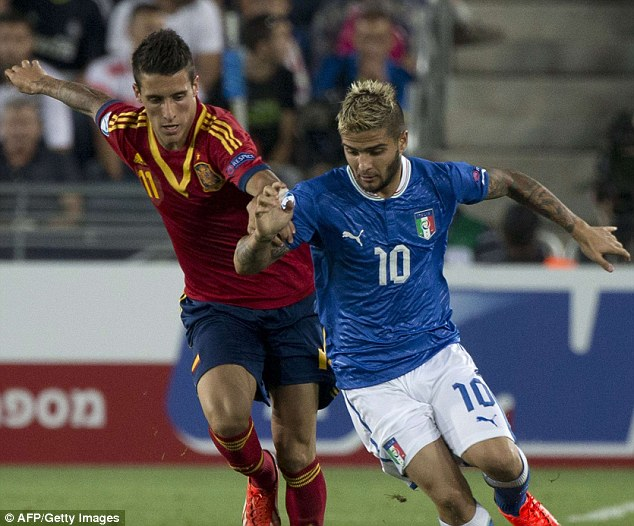 Tussle: Spain forward Cristian Tello (left) challenges Italy's Lorenzo Insigne for the ball