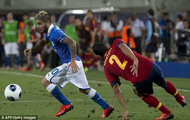 Effort: Italy's forward Lorenzo Insigne (left) advances with the ball past Spain's defender Martin Montoya