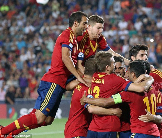 Group hug: Spain's youngsters celebrate Isco's goal, putting them 4-1 up