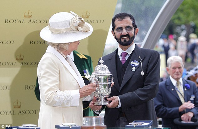Sweet success: Mohammed bin Rashid Al Maktoum is presented with a trophy by The Duchess of Cornwall Dawn Approach won The St James's Palace Stakes