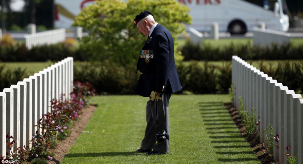 A Normandy Veteran looks at the headstones of fallen comrades at a remembrance and wreath laying ceremony to commemorate the start of the D-Day landings at Bayeux War Cemetery on June 6, 2013 in Bayeux, France