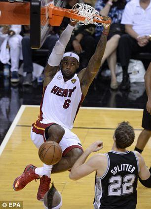 Up for it: LeBron James (left) slam dunks the ball