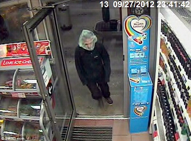Jamie Neil is caught on CCTV robbing a Co-op in St Austell, Cornwall with a clear plastic bag over his head