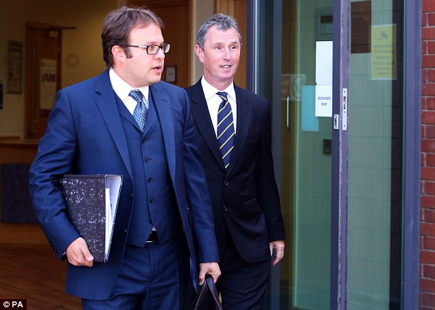 Deputy Speaker of the House of Commons Nigel Evans (right), leaving Preston police station with his solicitor