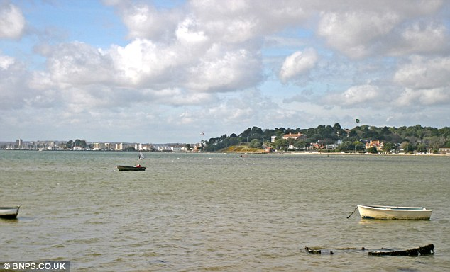 The property boast incredible view of the sea to the front and picturesque Poole Harbour (pictured here) to the rear
