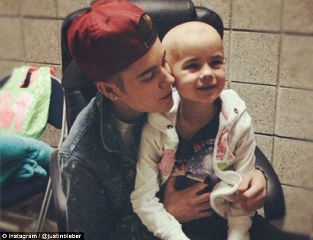 Meeting: The pop star visited Millie after she was too ill to attend his concert. He shared this image of their meeting on Instagram with the caption: 'Look at this bundle of joy... I love her'