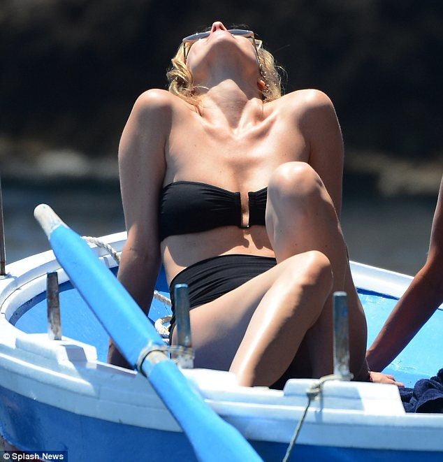 Kicking back, relaxing: The 40-year-old model looked more youthful than her years and she didn't look like she gave birth two months ago either