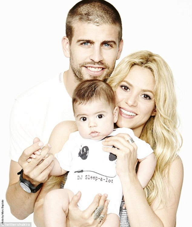 Happy family: Shakira posted this family portrait of her, Milan and Gerard on her Facebook page on Father's Day on Sunday