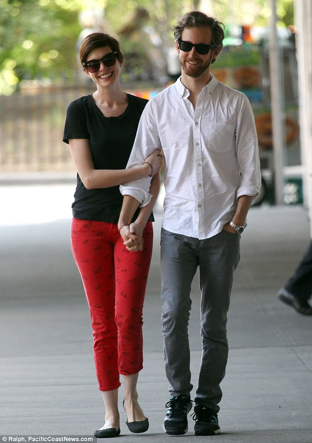 Like teenagers: Anne and Adam giggled as they walked hand-in-hand together while taking a break from filming