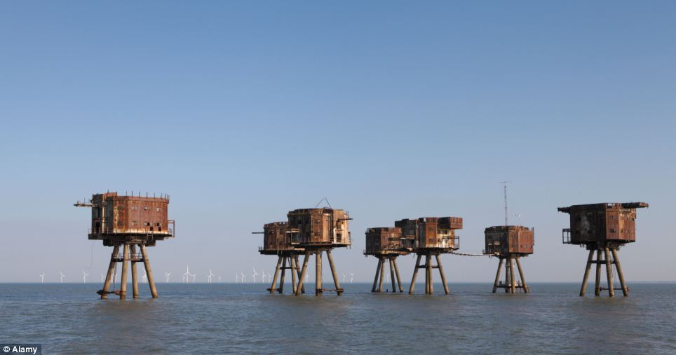 In the Thames estuary the abandoned wartime Redsands forts are rusting away, with Kentish flats windfarm on the horizon