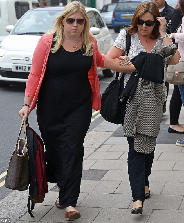 Family: Forrest's sister Carrie Hanspaul (left) and his mother Julie Forrest (right) at Lewes Crown Court