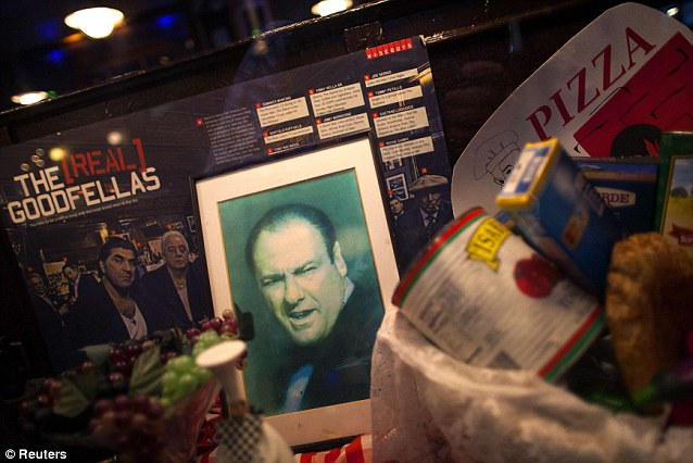 Tribute: Gandolfini's picture is displayed in the window of a restaurant in the Little Italy neighborhood of New York following his sudden death