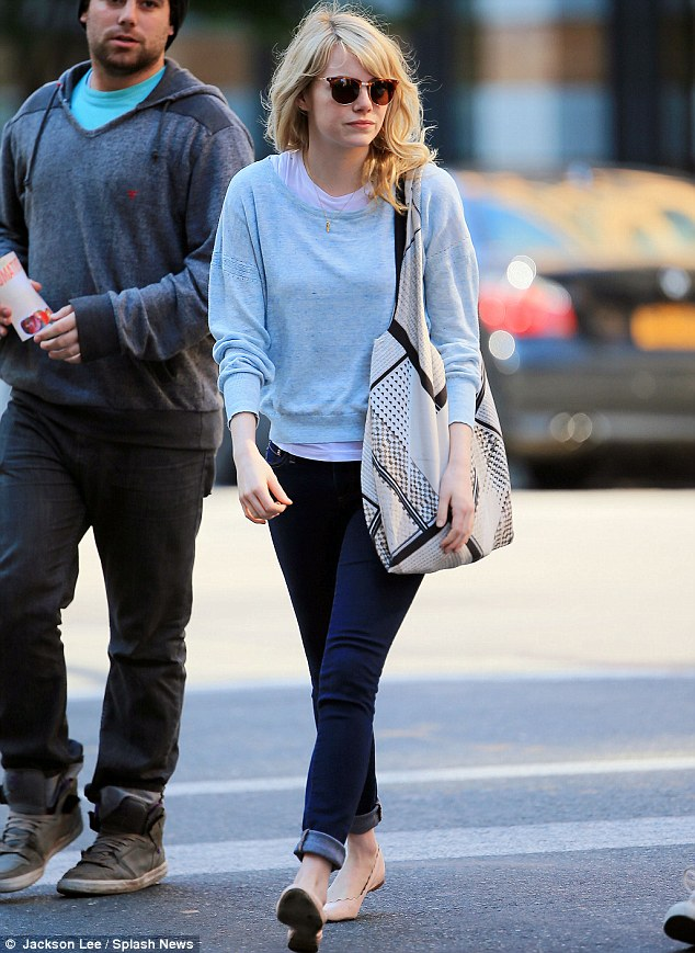Casually dressed: Emma wore a pair of blue skinny jeans and a grey sweater for her outing