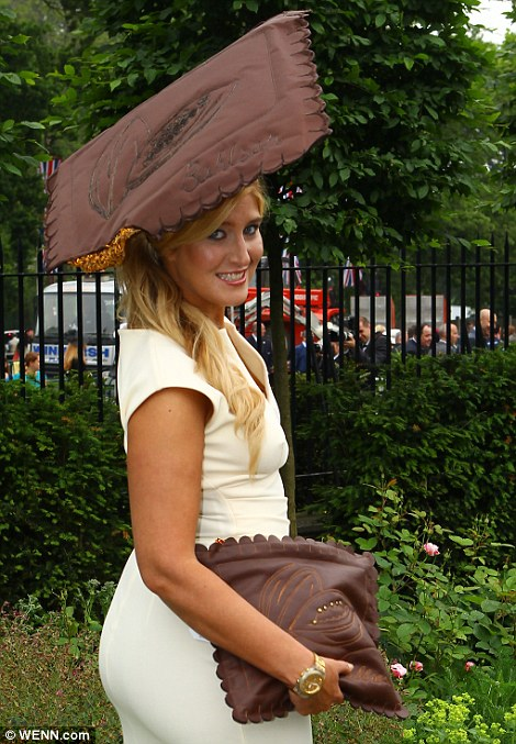 Made In Chelsea's Cheska Hull in a cream fitted dress accessorised with mahogany hat and bag