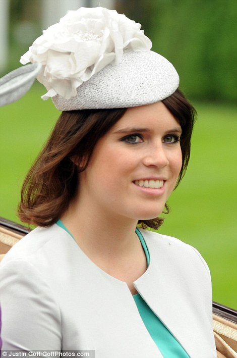 Princess Eugenie looked pretty in white and green on Ladies Day, while her elder sister chose to wear black