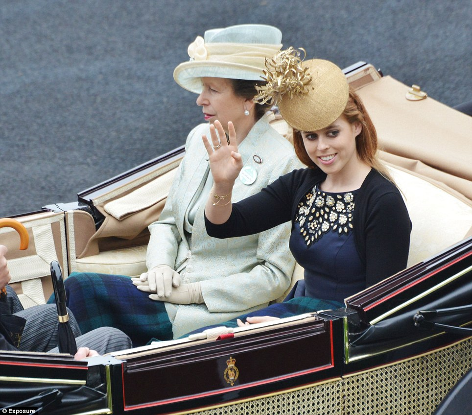 Princess Beatrice waves to the crowds as she and her aunt, the Princess Royal, make their way towards the Royal box