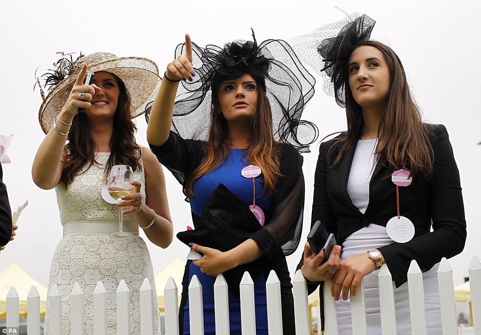 Female racegoers enjoy the atmosphere during Ladies' Day of the Royal Ascot meeting at Ascot Racecourse, Berkshire