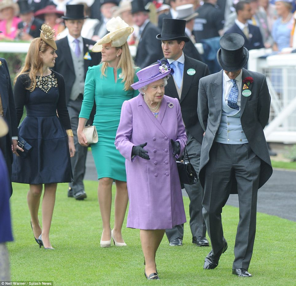The Royal party make their way towards the Royal box so the races can begin
