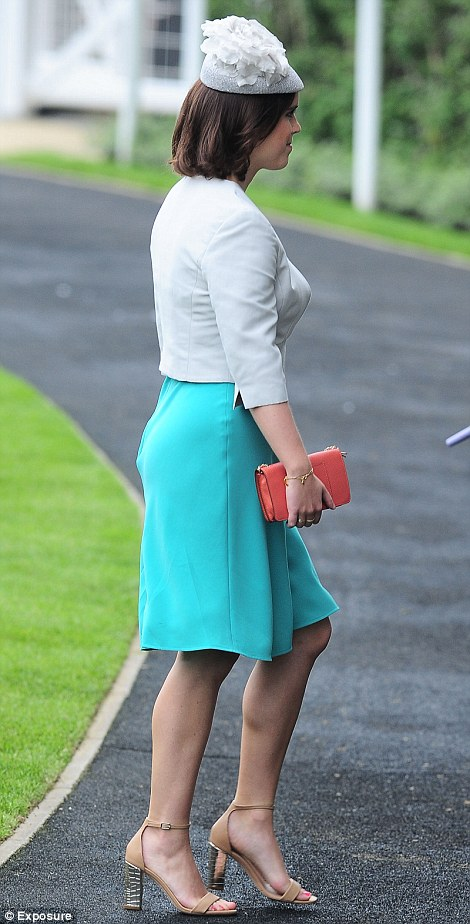 Princess Eugenie looked pretty in a turquoise dress and pale silver jacket and hat, accessorised with a small coral clutch and nude strappy sandals