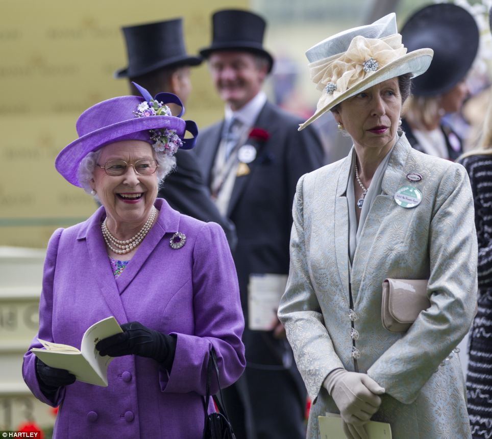 The Queen and Princess Anne watch the races on Ladies Day