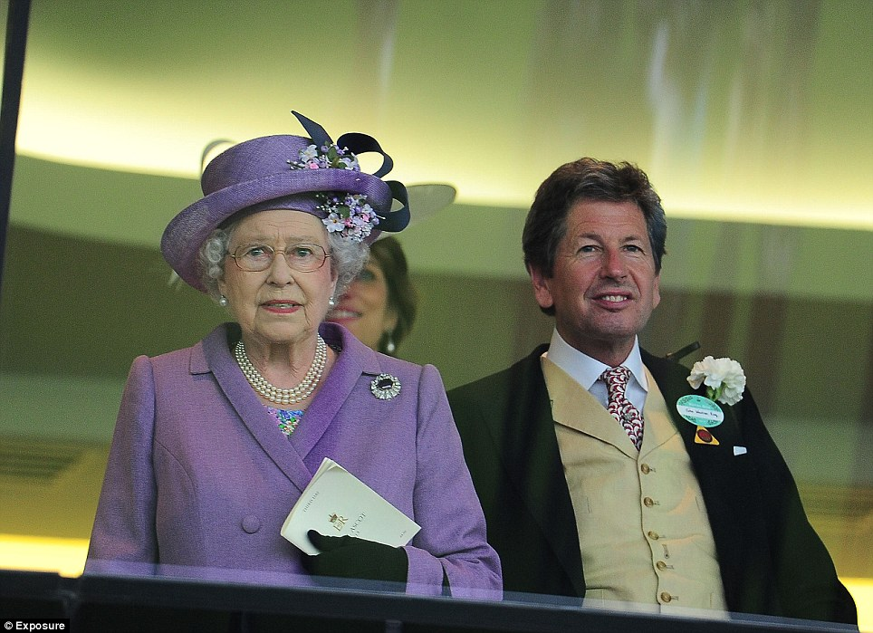 The Queen nervously watches as her horse Estimate rides in the Gold Cup