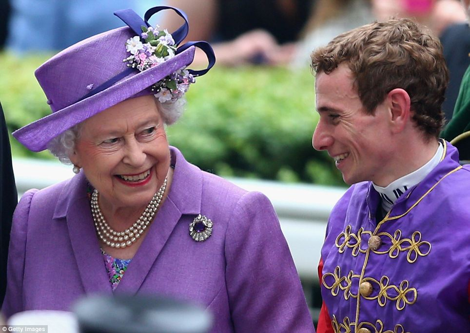 Queen Elizabeth II talks with Jockey Ryan Moore after the Queen's horse Estimate won The Gold Cup on Ladies' Day during day three of Royal Ascot