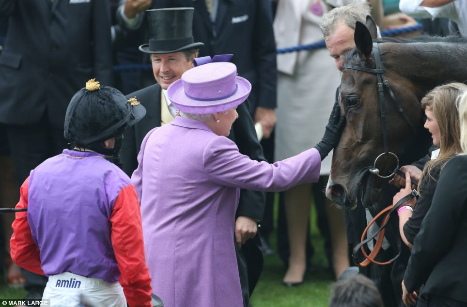 The Queen greets her horse Estimate  in the parade ring after it won the Gold Cup