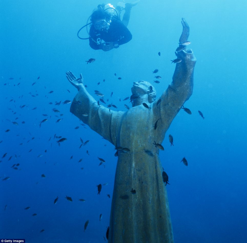 This statue of Christ now has only fish for company at San Fruttuoso, Italy