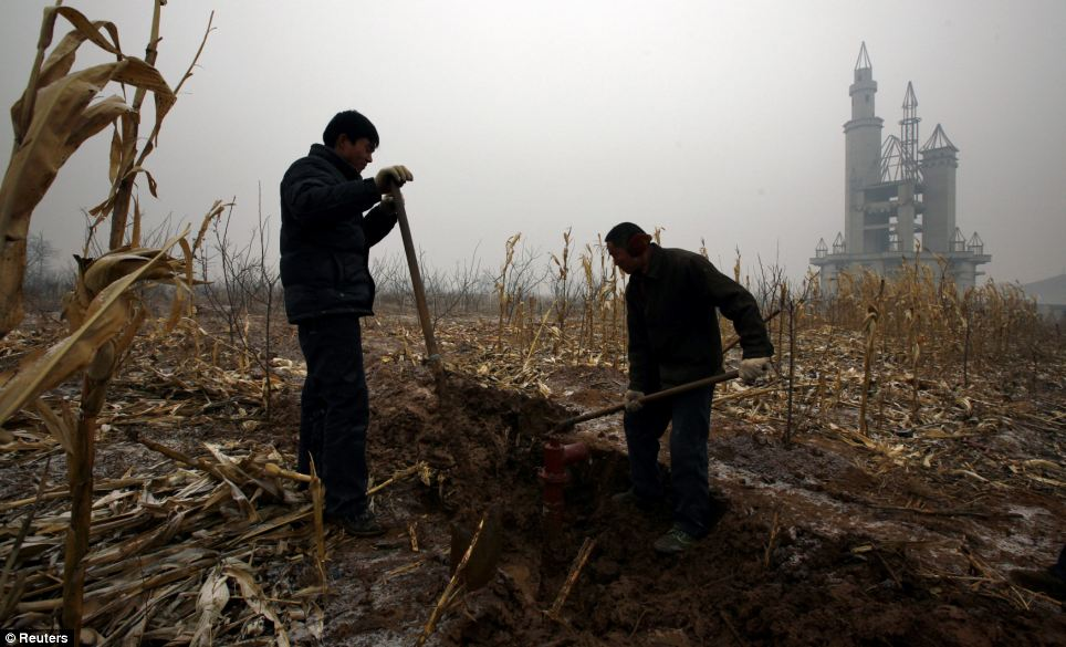 Farmers dig a water well in a field that should have been landscaped gardens for the enchanted castle