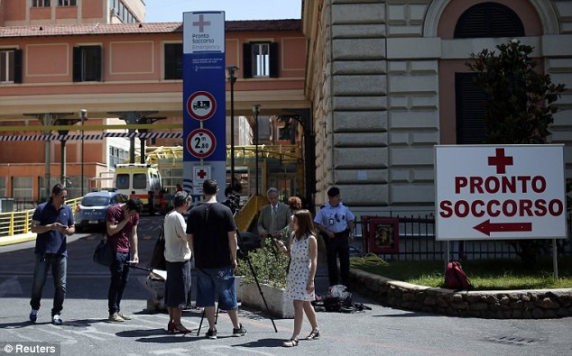 At the hospital: Members of the media gather outside the emergency department of Policlinico Umberto I