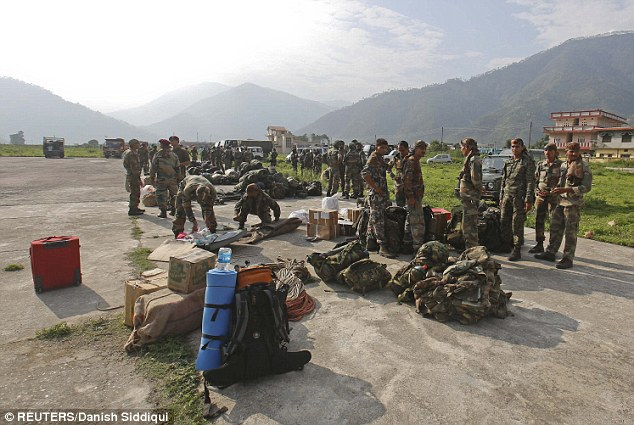 Army Paratroopers prepare to leave for rescue operations at an airfield in Gauchar