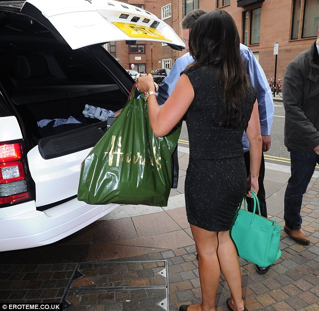 Helping hand: A member of staff helped Tamara load her shopping bags into the car
