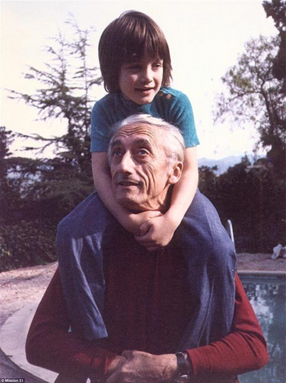 Fabien Cousteau is pictured as a young boy on the shoulders of his grandfather, famous French explorer Jacques-Yves Cousteau