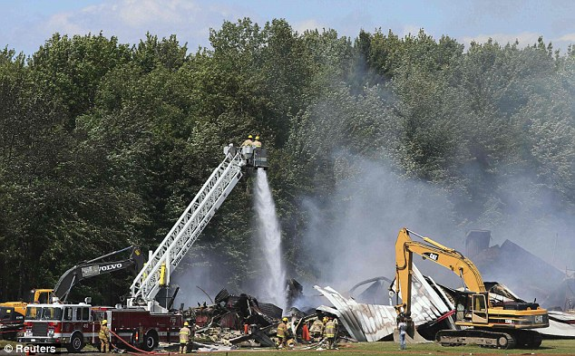 Flames: Firefighters had the raging fire under control by early Thursday afternoon