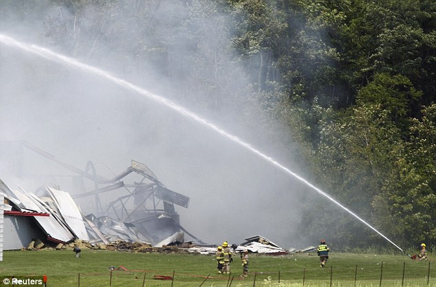 Hose: Firefighters work at the site of an explosion at a fireworks factory at Coteau du Lac, west of Montreal, Quebec