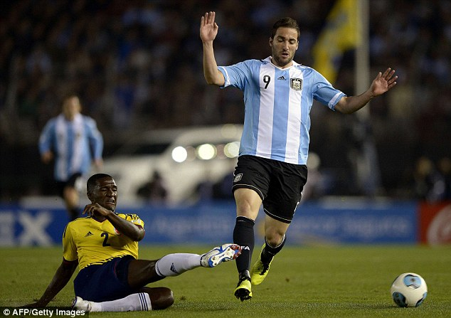 Hopeful: Arsenal are chasing Argentine Gonzalo Higuain (right) from Real Madrid