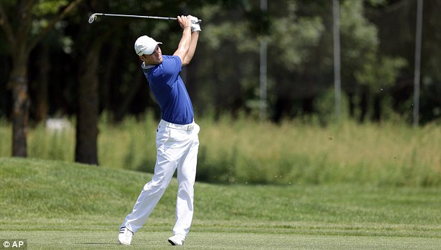 Just behind: Martin Kaymer trailed Els by a shot at the end of the first round in Munich