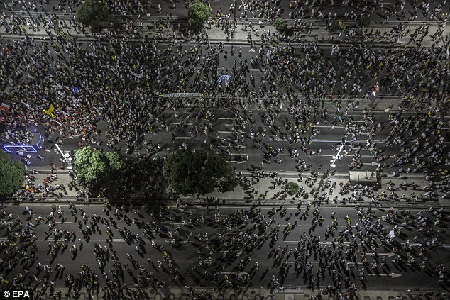 Outrage: Thousands of Brazilians have taken to the streets during the last few days