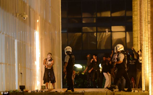 Attack: Military police approach protestors trying to invade the Foreign Ministry, during an anti-government protest in Brasilia