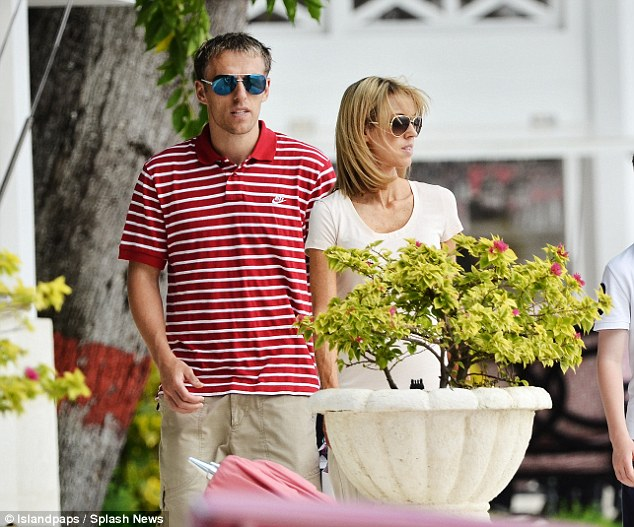 Relaxed: Phil Neville took a break in Barbados with his wife and children