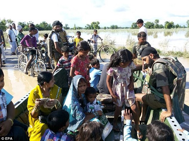 Helping hand: Army troops in rescue operations in flood hit areas in Pilibhit, Uttar Pradesh