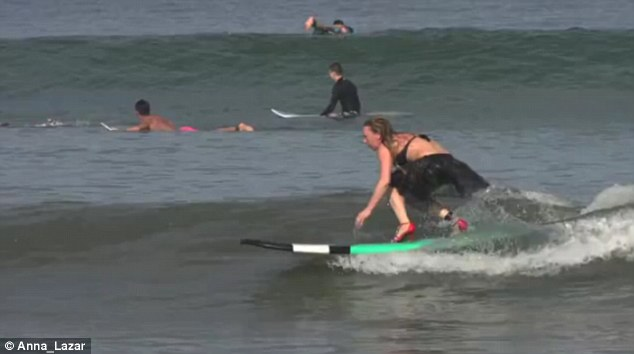 A group of Russian woman went to Bali to compete in a surfing in high heels competition