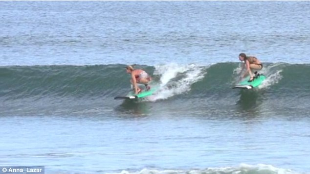 Two competitors managed to catch a wave simultaneously while wearing their heels