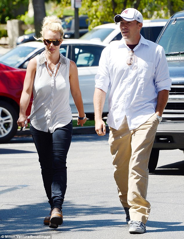 Too hot for jeans: Britney squeezed her curvy figure into a pair of tight-fitting dark jeans, which looked uncomfortable on such a hot day