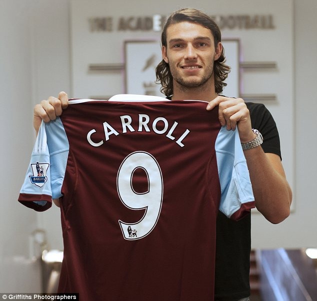 Signing on: Carroll shows off his No 9 Hammers shirt