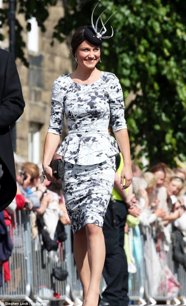 Sophisticated: Pippa wears a white and black patterned peplum dress, with a black fascinator and black patent leather heels