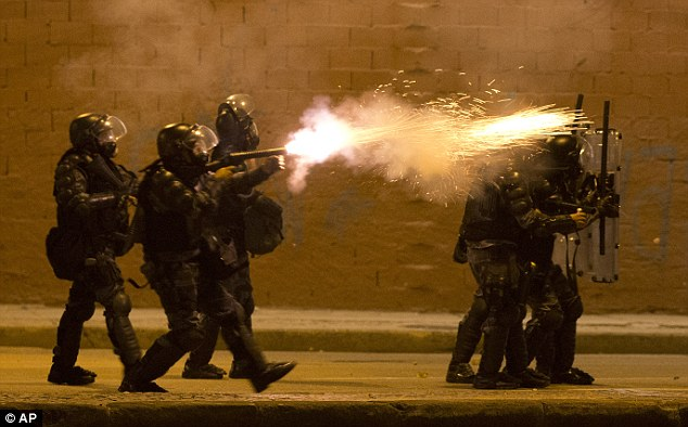 Force: A military police officer fires tear gas at protesters during anti-government demonstrations in Rio